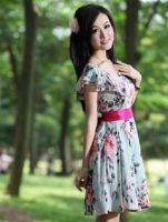 Asian fashion woman holding a umbrella on white