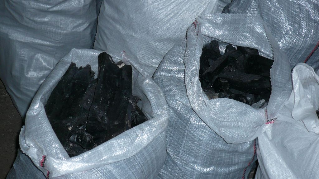charcoal, wood briquettes and wood punctured