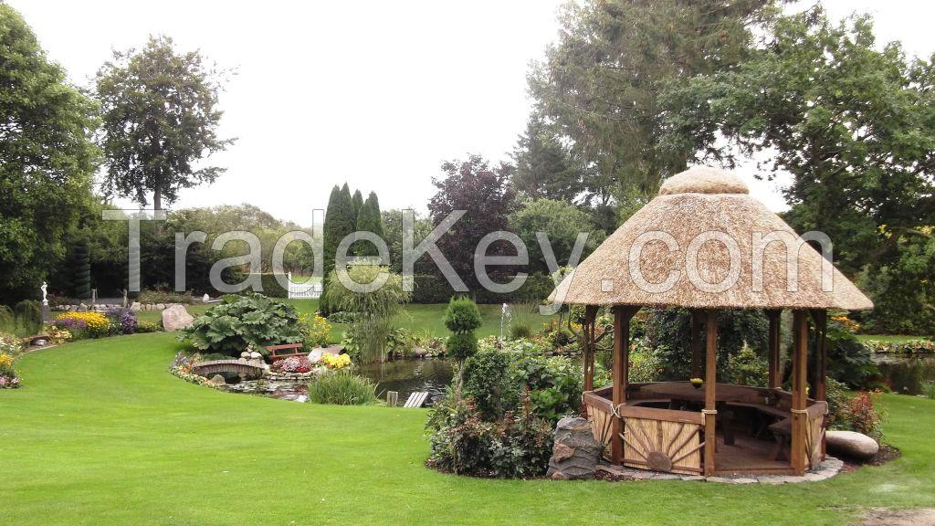 Pavilion. Gazebo with reed roof. Thatched gazebo.