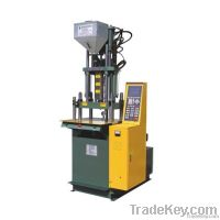 vertical screw injection molding machine