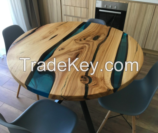 Tables made of wood and resin with forged underframes