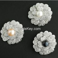 pearls and CZ flower shaped pendants/brooches