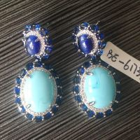 big turquoise stone earrings with white rhodium plating