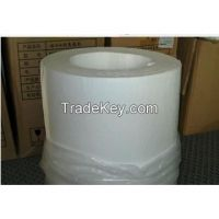 Treated fluff pulp for diapers and sanitary napkins