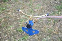 metal 3-arm water sprinkler on step spike