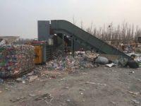 Horizontal waste plastic baler with conveyor