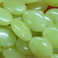 Sell olive jade oval beads