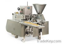 Filling and wrapping machine of processed cheese