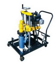 DRILLING AND CORE COLLECTING MACHINE