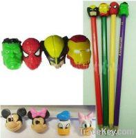 pencil with top figurine