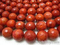 Sell bamboo coral faceted round bead 14mm