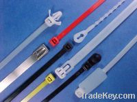Sell releasable, push mount and knot cable tie