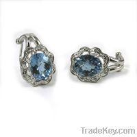 Sell  925 sterling silver blue topaz earrings leverback