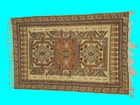 vintage handmade wool rug with intricate patterned  design