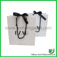 White paper bag with black silk ribbon