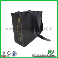 paper bag with silk ribbon
