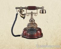 red wood-like antique telephone