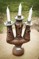 Ceramic candlestick for three candles