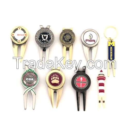 Golf Product, custom golf divot tools with a removable magnetized ball marker.