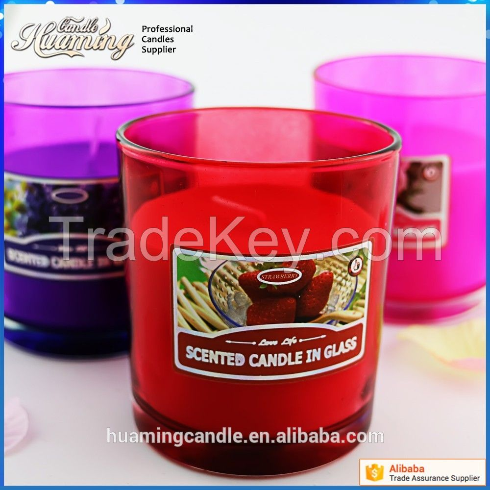 scented candles in colored glass jar