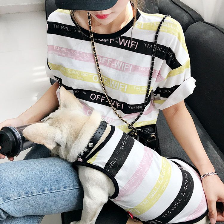 Striped clothing T shirts matching dog and owner clothes