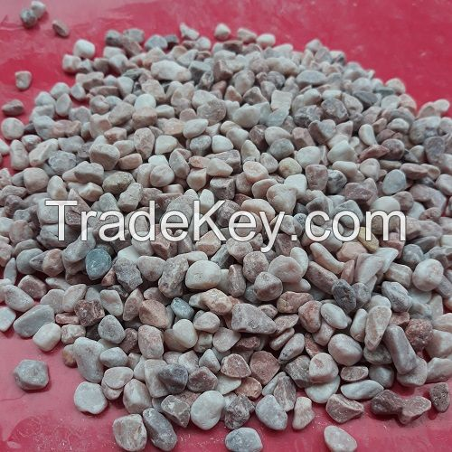Pink pebbles for aquarium and garden paving