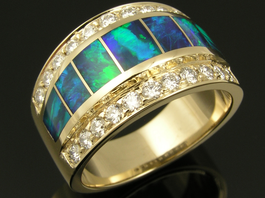 14k gold ladies ring inlaid with Australian opal accented by diamonds.