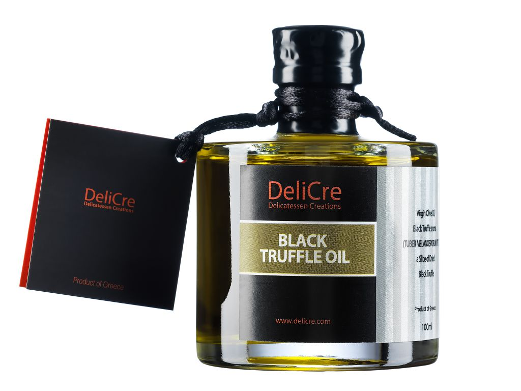 Black truffle aroma olive oil with a slice of dried black truffle inside