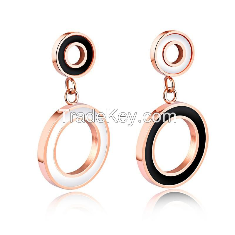 Designer inspired gold tone stainless steel fashion dangling earrings