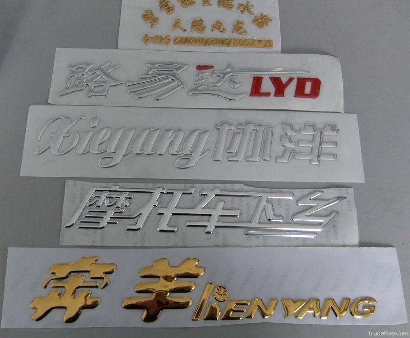 car emblem, car badge, chrome auto emblem