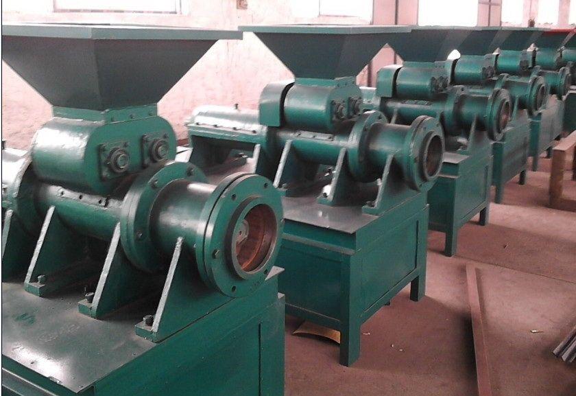 Coal and charcoal extruder machine