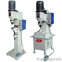 Pneumatic spin riveting machine