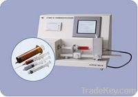 Testing instrument for syringes, needles, and other medical devices
