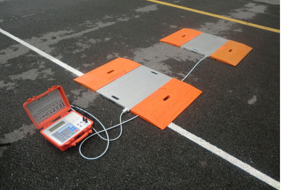 Portable axle weighing pad scales for truck weigh