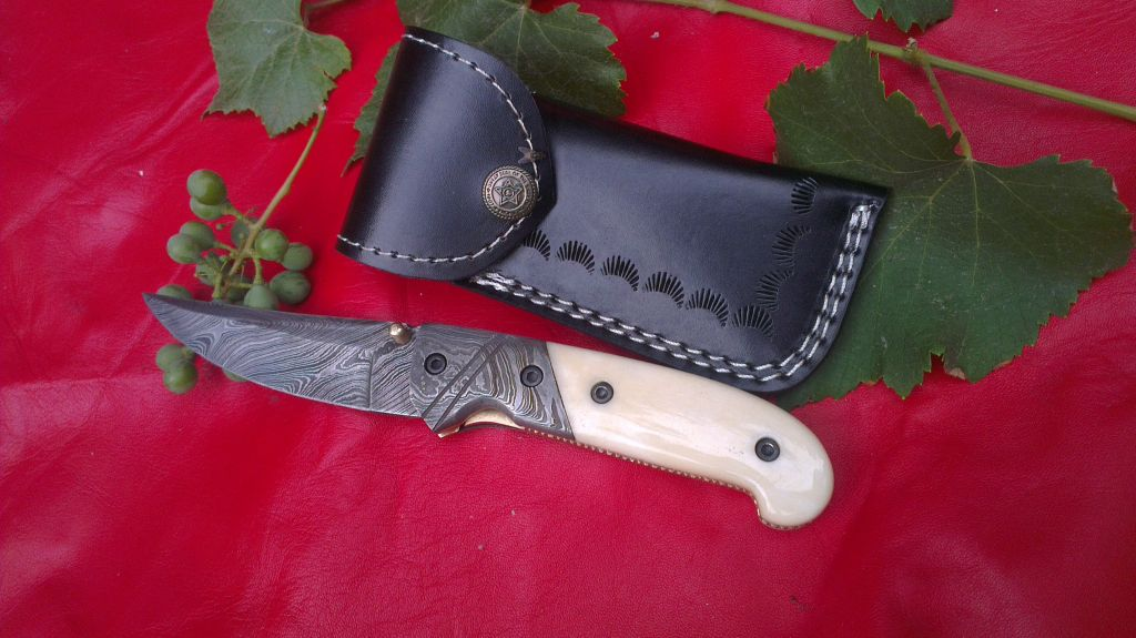 Damascus hand made folding knife with leather sheet
