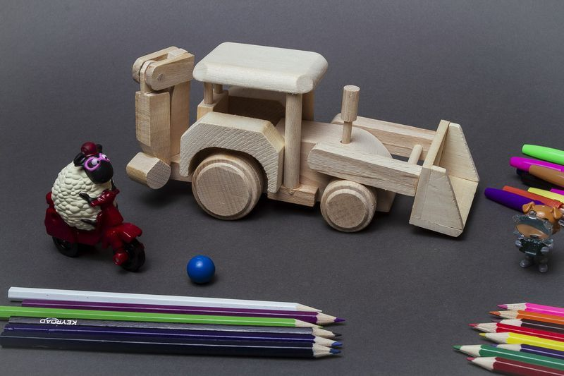 Wooden tractor for a boy.