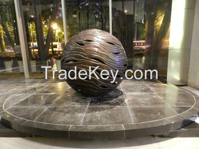 Large abstract cast brass ball sculpture