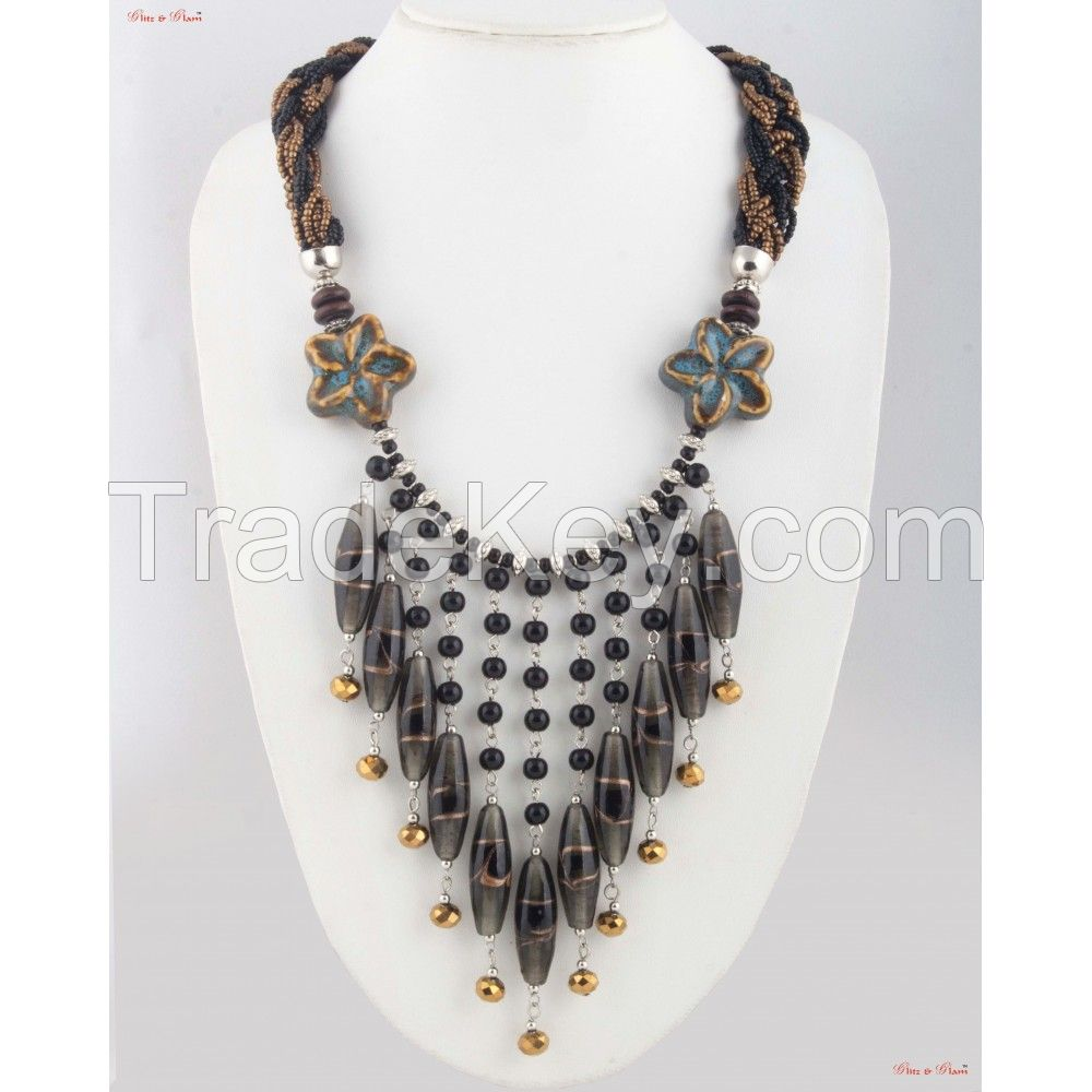 Fashion Necklaces - Dangle neck piece attached to a zigzag patterned cloth with a little bit of floral inspiration.