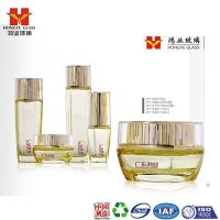 Luxury Packaging golden color empty cosmetic sets spray glass bottle with pump HY1587