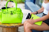Handbags with matching technology sleeves