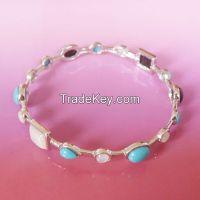 gemstone bangle with onyx, turquoise, cat's eyes, shell stones