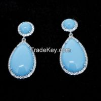 resin turquoise stone earrings set with tiny CZ