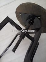 Antique metal industrial stool