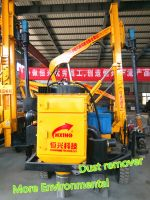Rock drilling machine pile driver with dust remover for hard construction site