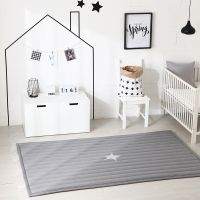 100% cotton rug with silver colored little star