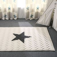 100% cotton rug with black star