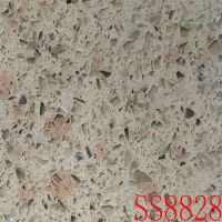 Quartz stones with cream-colored background and slight pink and green patches