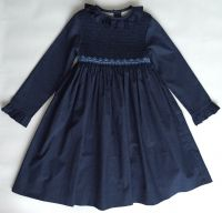 Hand smocking and embroidery in cotton & linen.