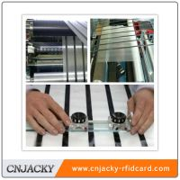 coated overlay with coated overlay with magnetic strip