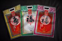 Raw rice vacuum packaging heavy-duty 3-sides-seal handle bag